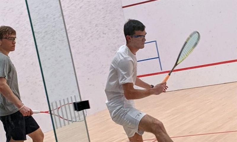 Alvaro Magaña '19 practices squash in the Mitchell Athletic Center.
