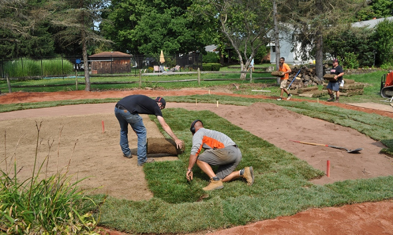 Denison groundskeeping staff building the field
