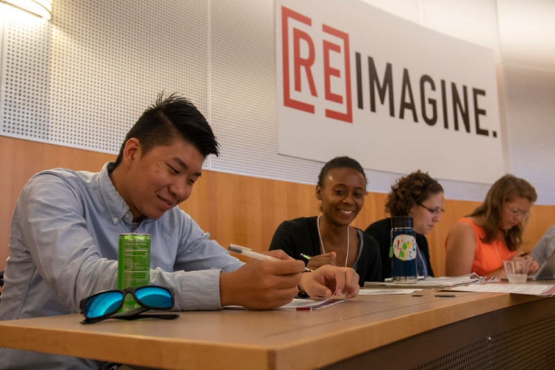 Students filling out worksheet at Remix
