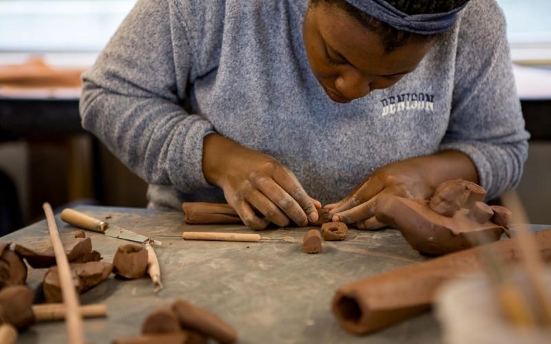 Sculpture student working