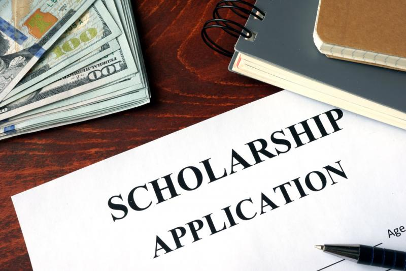 scholarship application with money and books
