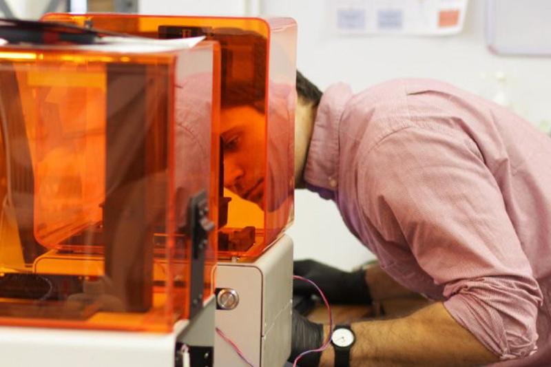 Adam Lebovitz '12 inspecting laser printing process