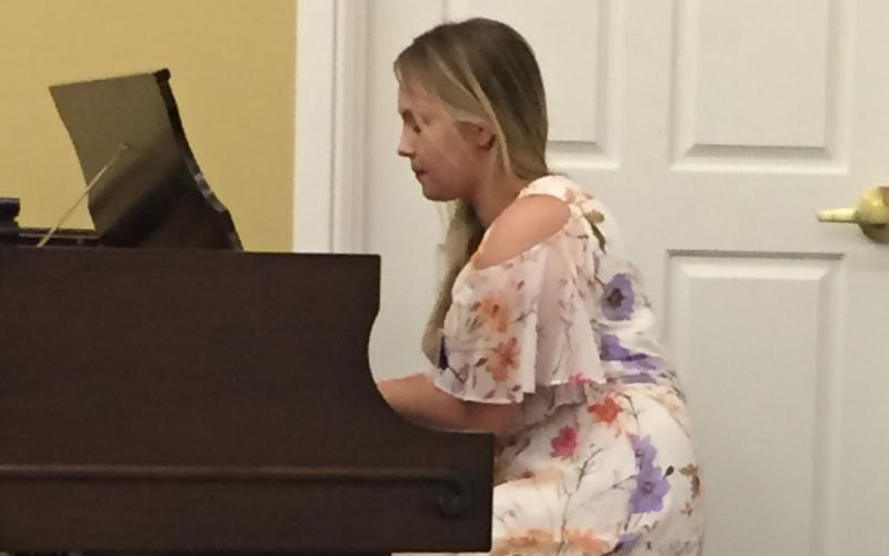 Amanda playing piano