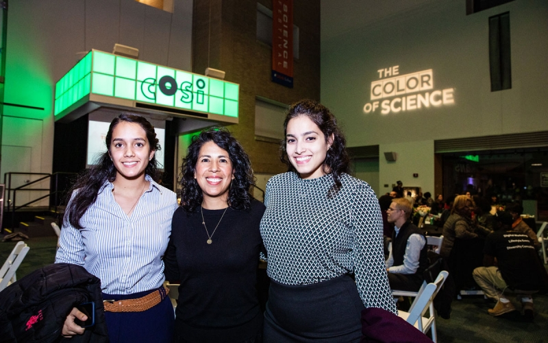 Prof Aguilar with two students at COSI