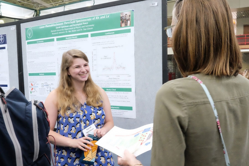 Student presenting her research to woman