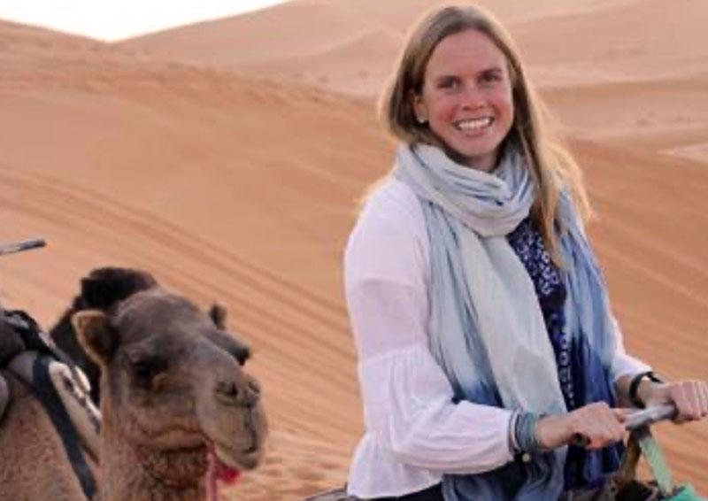 Chloe Rekow riding a camel