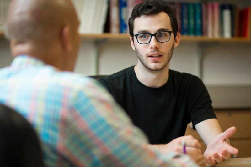 Student talking to professor