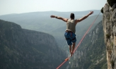 Person balancing on tight rope
