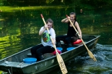 Students rowing a boat
