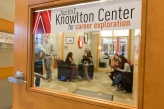 Door of the Knowlton center looking in at students