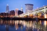bridge over water with city lights
