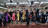 Members of the Denison Class of 2018 toss their mortarboards