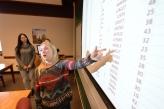 Student explaining data sheet