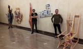 Students with artwork