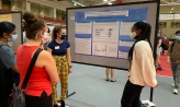 Students presenting their summer research poster