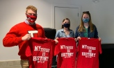 """Senior student researchers with t-shirts that read """"My research is history"""""""
