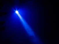 Photo of a spotlight above a stage
