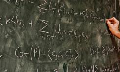 Teaching physics on chalkboard