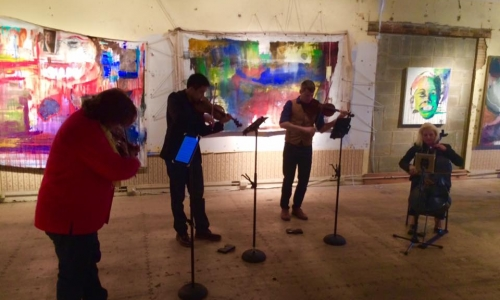 Musicians playing at Denison Art Space in Newark