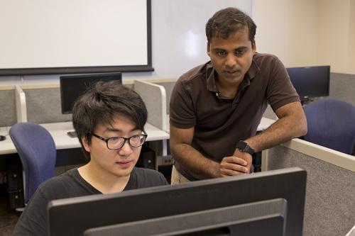 Student Junbo (Larry) Li with professor Ashwin Lall