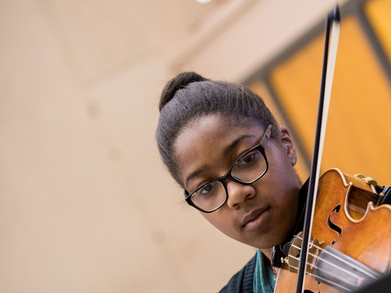 Music student playing the violin