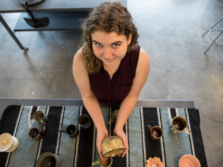 Studio Art student showing off her ceramics project