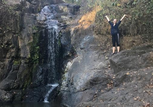 Bailey Greene '18 by waterfall in Cuba