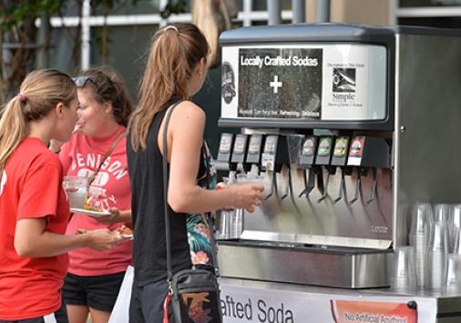 Girl at soda machine