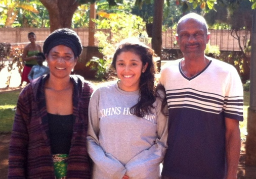 Adela Hoffman '10 with her Peace Corps homestay parents in Mozambique.