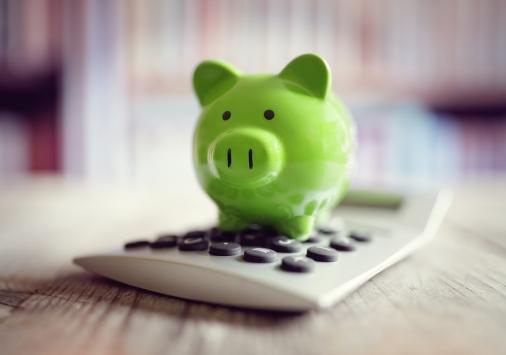 Piggy bank on calculator