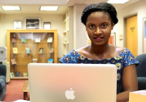 Hali Bah sitting with laptop