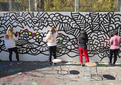 Students creating a mindful graffiti wall