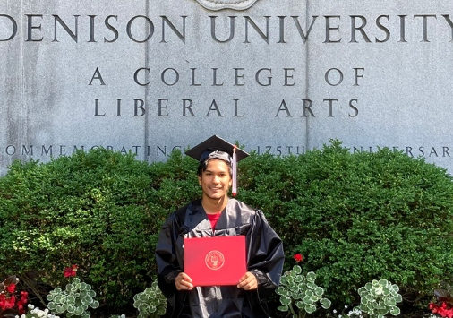 Taka Higuchi '20 celebrating commencement