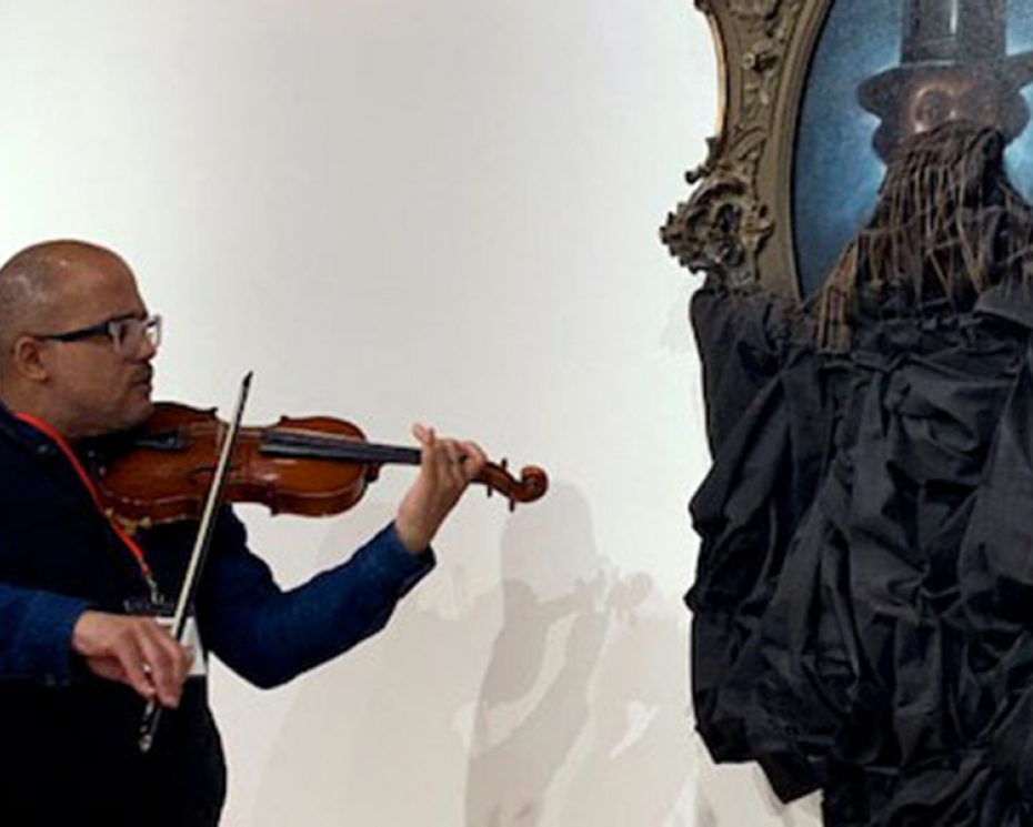 Daniel Roumain playing in concert with Titus Kaphar's A Disturbing Silence
