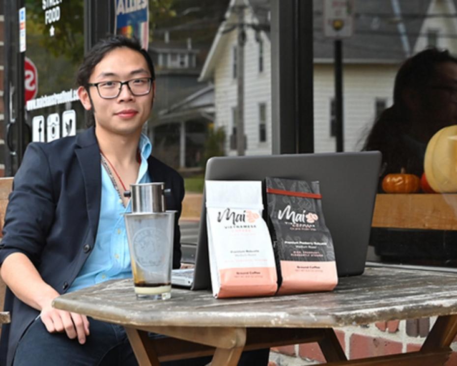 Mai Coffee start up owner Alan Phung '22 outside restaurant Mai Chau