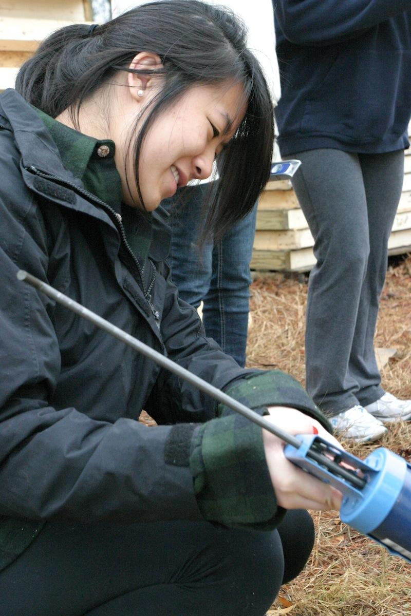 Jenn Nguyen '15, working for Habitat for Humanity.