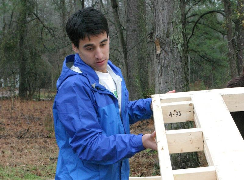 Charlie Allen '14, working for Habitat for Humanity.