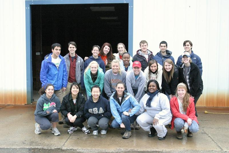 Tori Couch '13 , middle row, second from the right, during a Habitat for Humanity Winter Break trip in 2012.