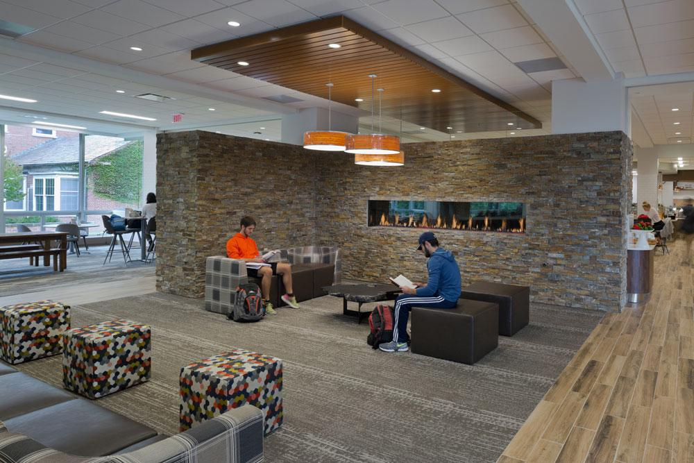 A Stone Wall And Fireplace In The Center Of Curtis Dining Room Creates Comfortable Lounge For Eating Also Spending Time After Hours