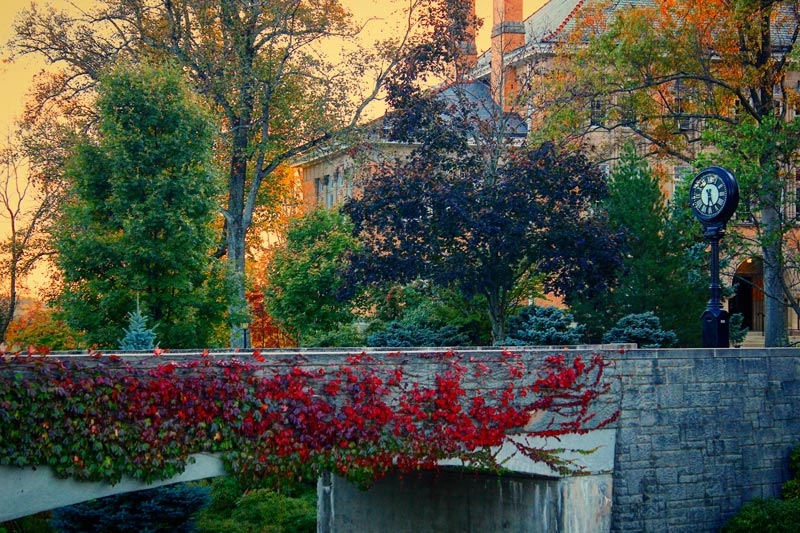 The campus footbridge with Doane Hall in the background in the fall