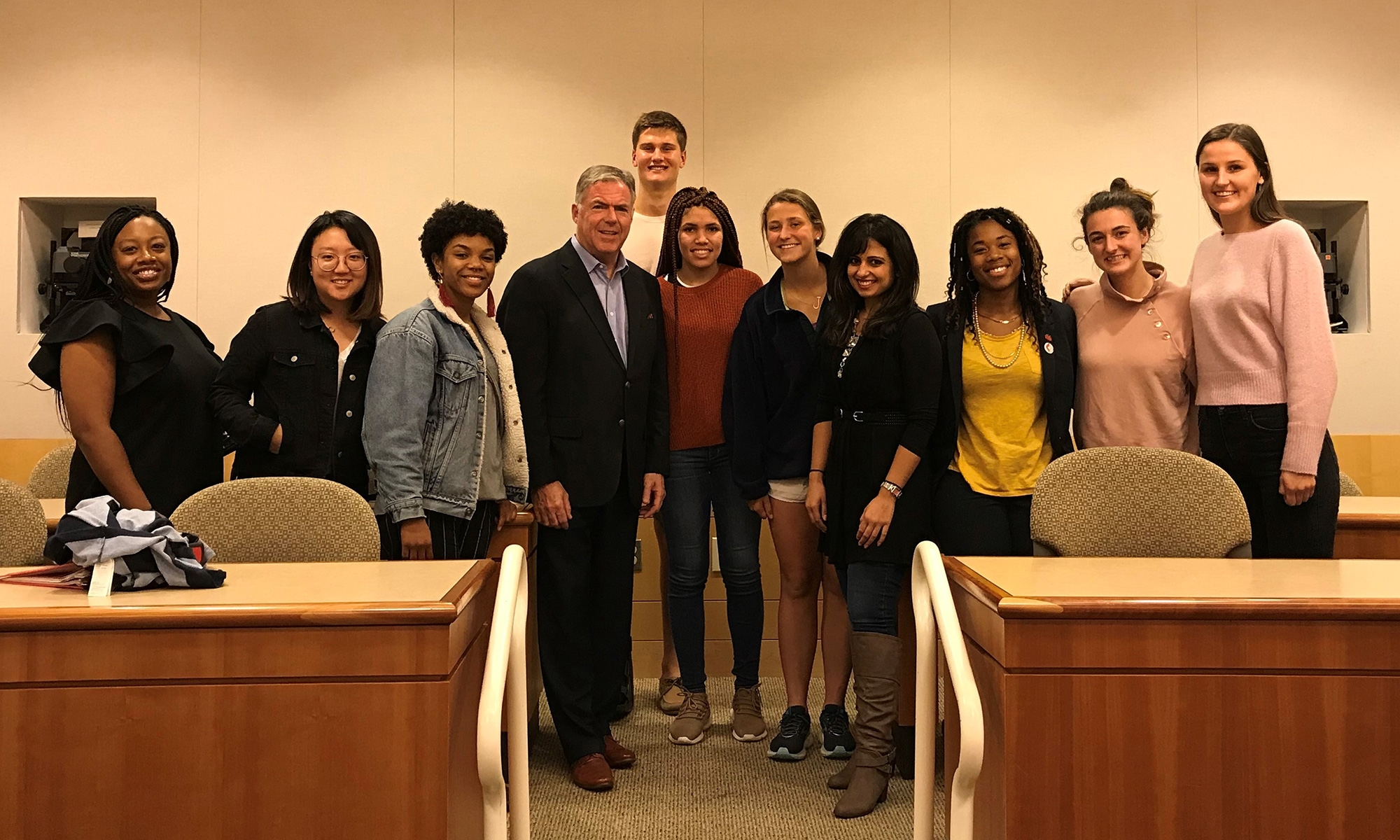 Matthew Harrington '84 and Monisha Mukhija '11 with students