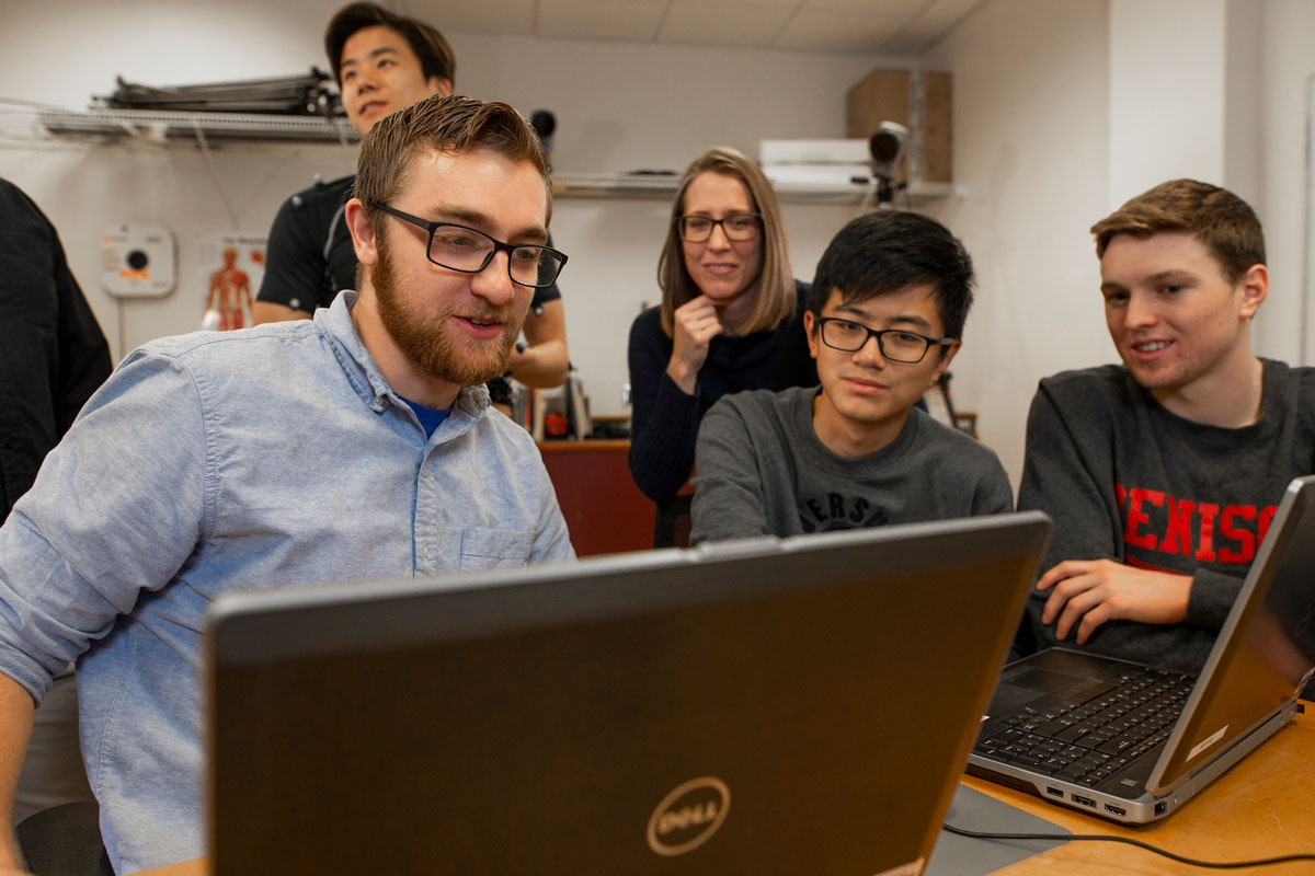 Students looking at data with a professor