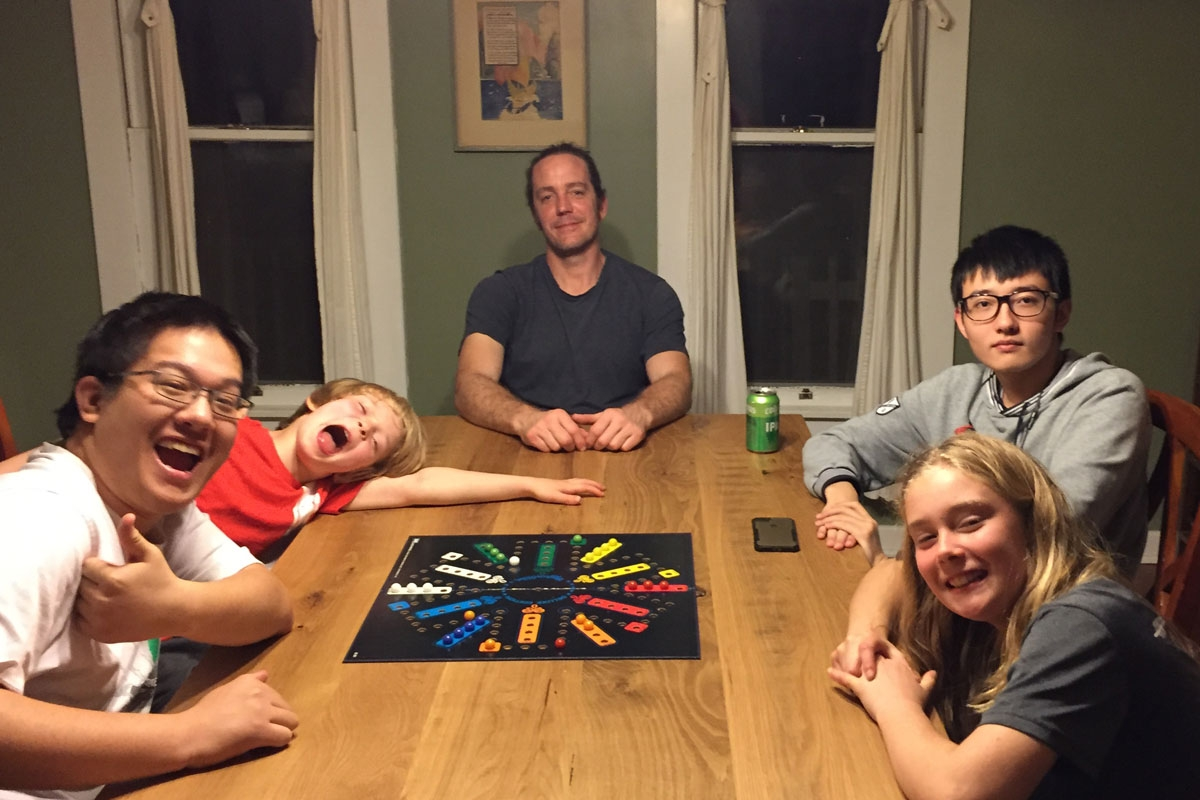 Family and students playing board games