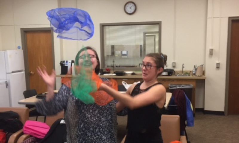 Arin Caveney and Maya Hodson practice their juggling skills