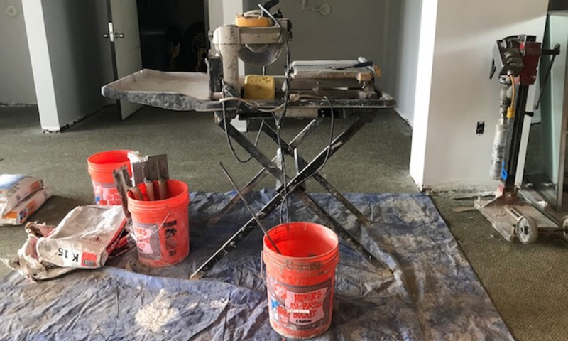 Paint buckets and other renovation materials
