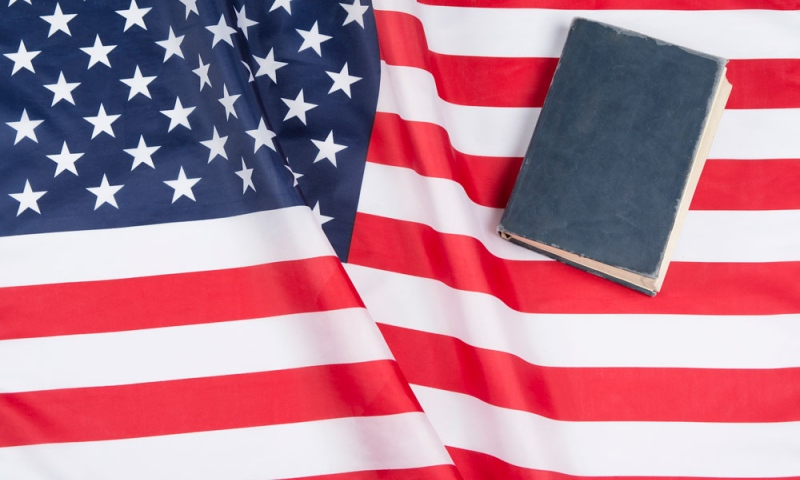 American flag with book on top of it