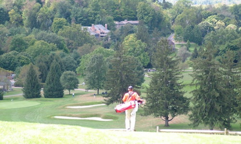 Man golfing at Denison Golf Club