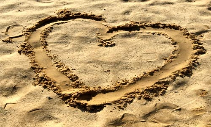 image of a heart drawn in sand