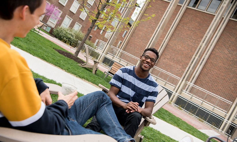Students chatting on the academic quad