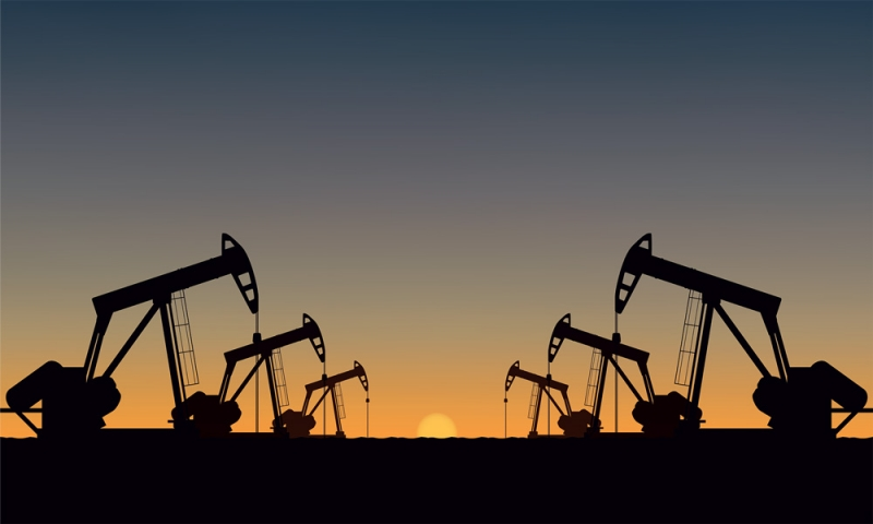 Silhouette Oil pumps at oil field with sunset sky background.